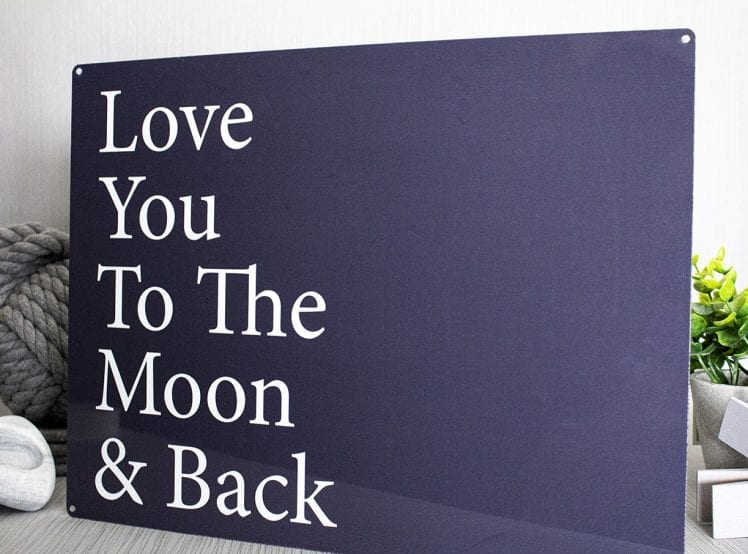 love you to the moon and back metal sign