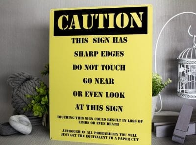 CAution this sign has sharp edges funny metal sign