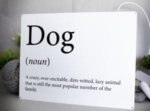 White metal sign with funny dog dictionary meaning
