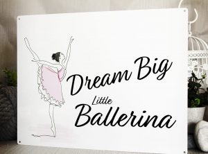 """White metal sign with a water colour ballerina. Wording says """"Dream Big Little Ballerina"""""""