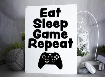 Black and white metal sign with the words Eat, Sleep, Game,Repeat