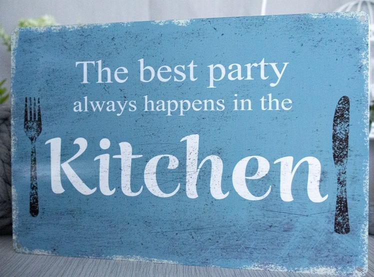 The best party's always happen in the kitchen metal sign