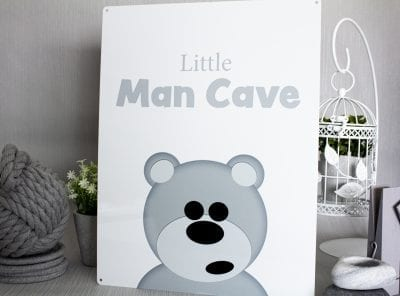 Cute little man cave metal sign