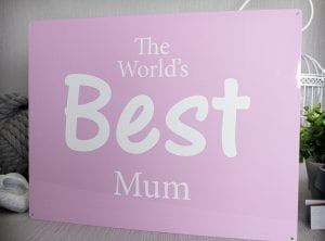 The world's best mum metal sign with pink background and white text