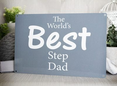 Grey metal sign with the words The world's best step dad in white text