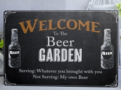 Black metal sign saying welcome to the beer garden