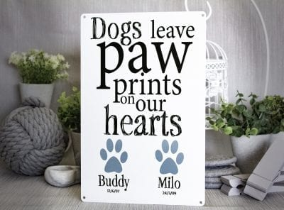 Dogs leave paw prints on our hears customised metal sign