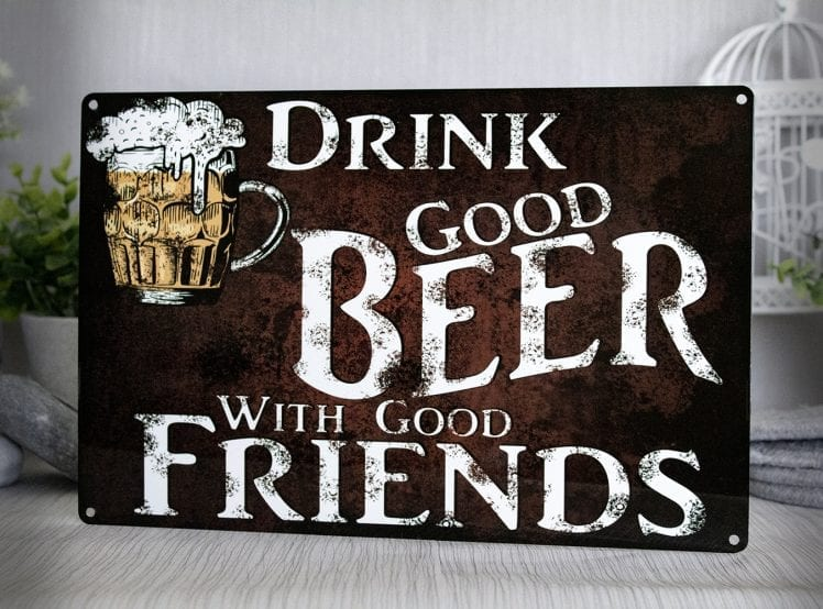 Rustic metal sign with the words Drink good beer with good friends
