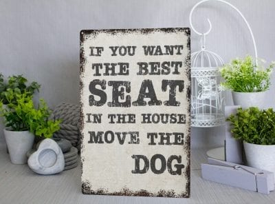 Rustic metal sign that read, if you want the best seat in the house, move the dog