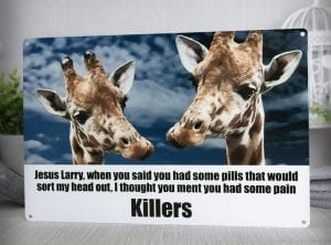 Giraffes on pills Metal sign