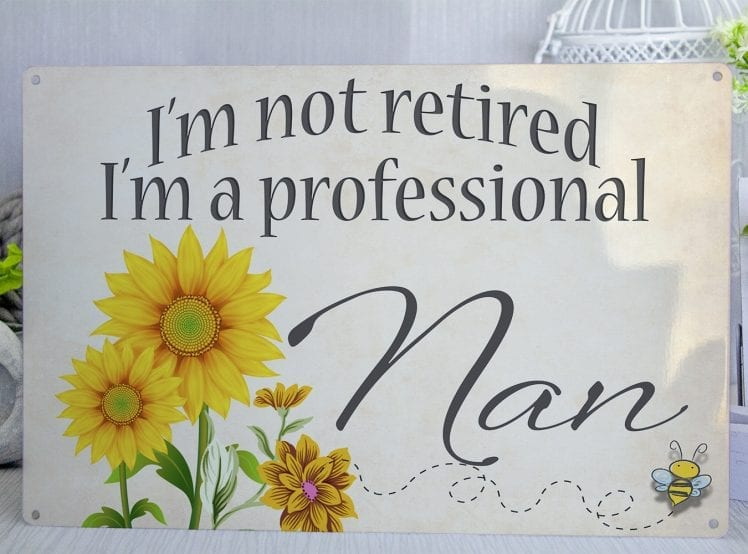 I'm no retired I'm a professional nan cream metal sign with sunflowers