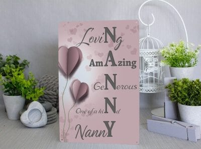 Pink metal Acrostic Nanny sign with paper heart balloons