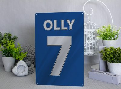 Blue football shirt metal sign with white name and number which can be personalised