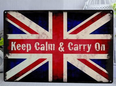 Red, white and blue Union Jack distressed metal sign with the words Keep calm and carry on written across the middle