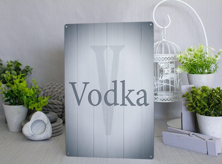 Vodka grey wood style metal sign with a light grey v and the words vodka written overit in dark grey text