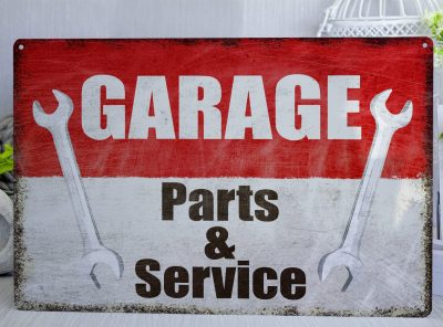 Red and white distressed Garage Parts and service Metal Sign
