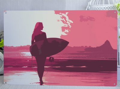 Pink and White Silhouette of a female surfer walking towards the surf