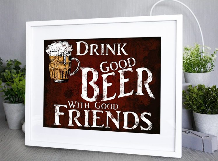 This print has a Dark red rusty background with an illustrated pint of frothy beer and white text that reads Drink good beer with good friends
