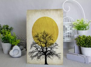 Black silouhette of a tree with a sun in the background on a beige artistic background Metal Sign