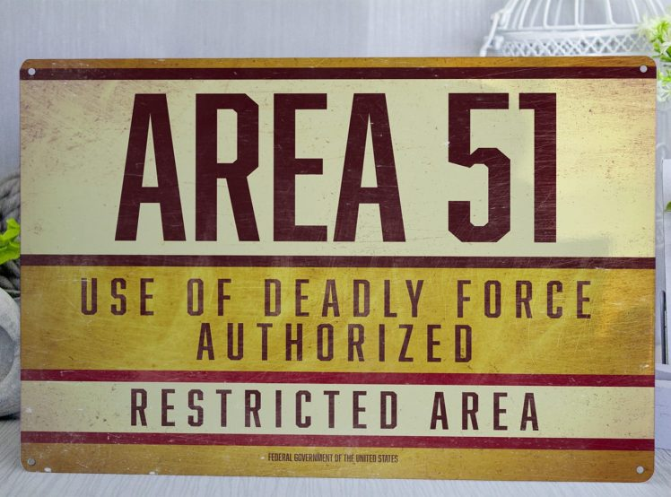 Yellow Retro style Area 51 metal sign with the text Area 51 use deadly force authorized Restricted area