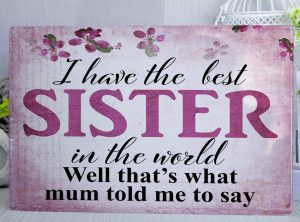 Pink floral metal sign withe the wordsI have the best sister in the world. Well that's what mum told me to say