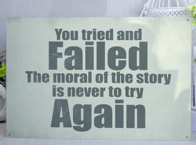Green metal sign with the words you tried and failed. The moral of the story is never to try again