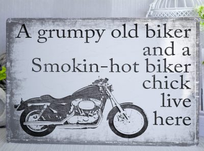 A grumpy old biker and a smokin hot chick live here