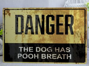 Danger the dog has pooh breath