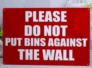 Please do not put bins against the wall