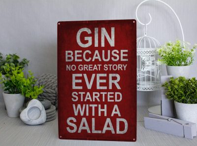 Red Metal Sign with white text that reads Gin Because no great story started with a salad