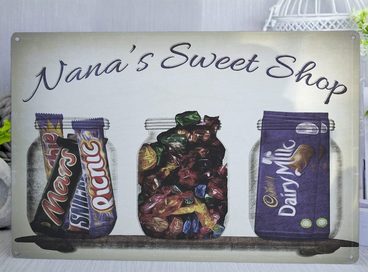 Metal sign with sweet jars on it